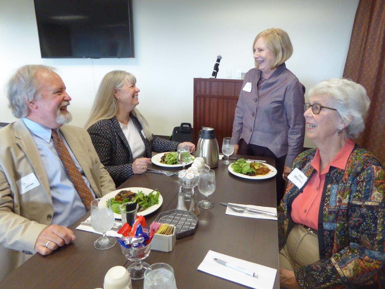 Past President Donna Peterson greets the Library contingent: Tim Johnson, Kris Keisling and Julia Wallace
