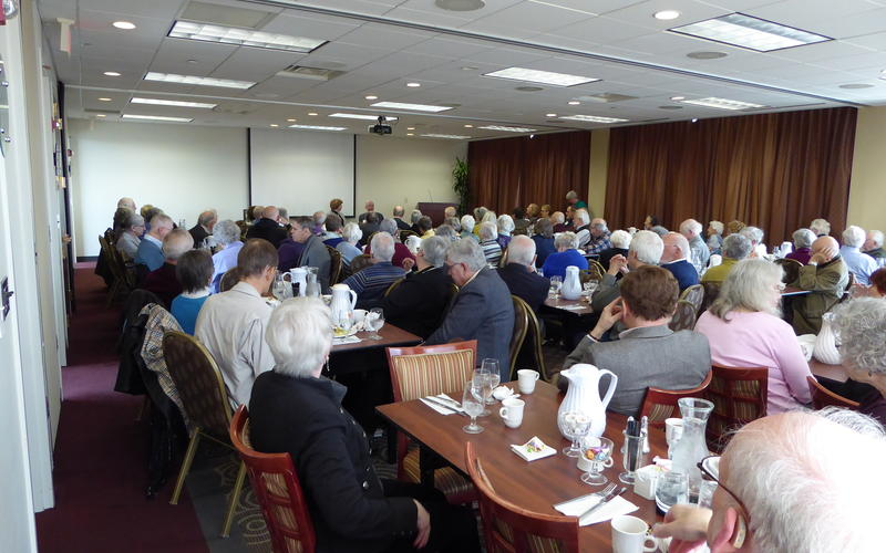 A crowded room hear Tom Swain and Lori Sturdevant's conversation March 2016
