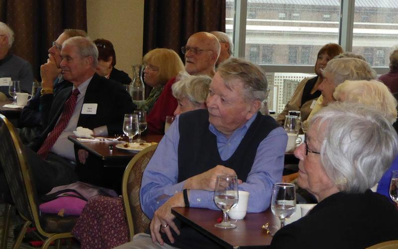 Members listen to Craig Packer speak about Africa lions at the November 2015 meeting