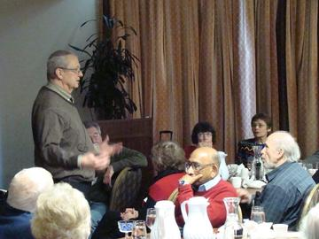 Lance Brockman respondes to audience questions at the March 2014 luncheon