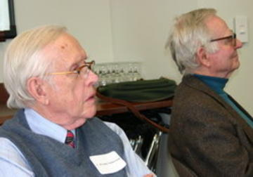 V. Elving Anderon and Warren Ibele entranced by Apostolos Georgopoulos' talk on brains