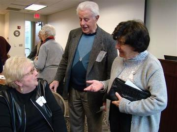 Richard Caldecott and Ellie Kendall speak with Joanne Eicher after her presentation