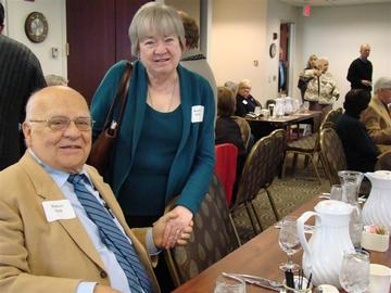 Bob Holt and newly retired VP Kathy O'Brien greet at the November 27 luncheon