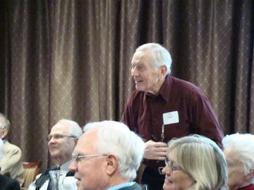 Ted Nagel rises with a question for guest speaker Kathryn Pearson at November's luncheon