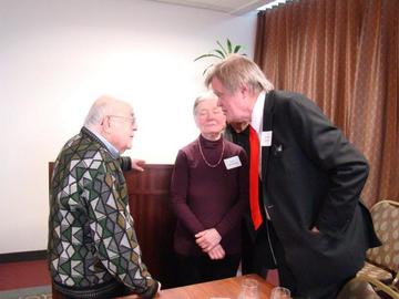 Hy Berman & Toni McNaron chat with Garrison Keillor at the February 26 luncheon meeting