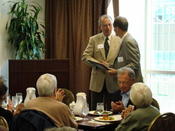 At the September 24th meeting, John Adams presents immediate past president Ron Anderson with a certificate recognizing his many contributions to UMRA