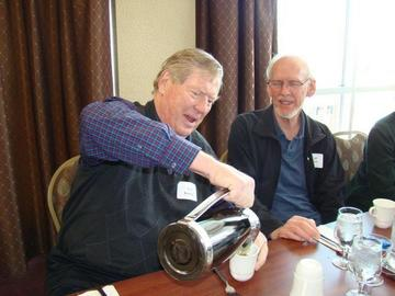 Calvin Kendall and Virgil Larson enjoy a cup of coffee at the February luncheon
