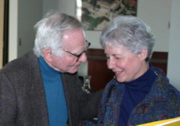 Warren Ibele scheming with Ginny Hanson at the January 2008 luncheon