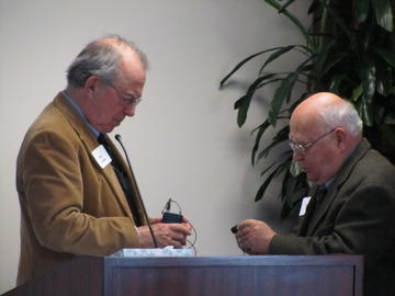 John Adams and Bob Holt work on the mic at the January, 2104 luncheon meeting