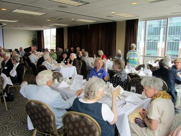 """May Gala Luncheon attendees enjoy """"white tablecloth"""" conversation"""