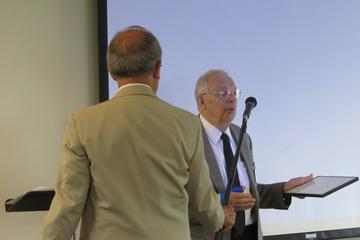 Earl Nolting is presented with the 2014 Award for Service to UMRA by President John Adams