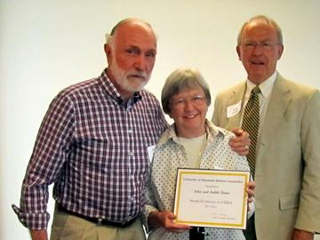 John and Judith Howe receive a 2014 Award for Service to UMRA From President Adams