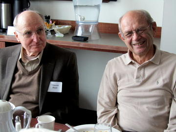 Vincent Hunt and Roger Schroeder share the February luncheon