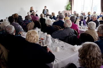 Krista Tippet and Ron Anderson hold everyone's full attention, speaking after the March Luncheon