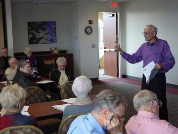 Andy Whitman of the Carlson School introduces a 3-part workshop series on finances for retirees after the October, 2015 luncheon