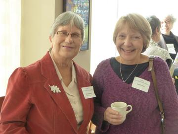 Book club chair Pat Tollefson (left) shared ideas with new member Susan Rose about starting a book club, Oct 25