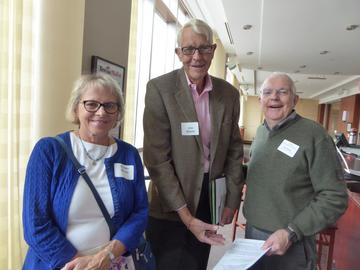 The  annual reception offers the opportunity for new members to learn more about UMRA. Karen and Jim Storm chat with Earl Nolting about the discounts members enjoy.