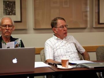 Virgil Larson works on the Member Database while John Anderson addresses the group