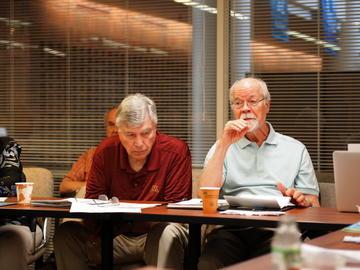 Hal Miller listens while Judd Sheridan discusses the Professional Development Grants Program